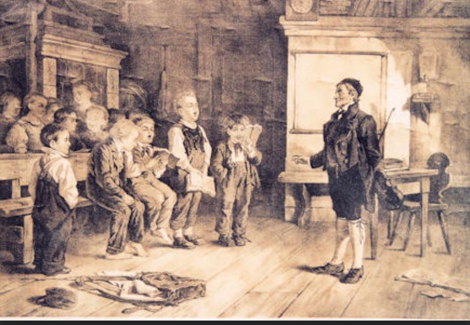 Impression aus einem Schulzimmer um 1800. Gerade wird gesungen.